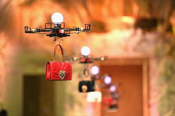 Dolce & Gabbana is using drones to model its handbags at Milan Fashion Week.